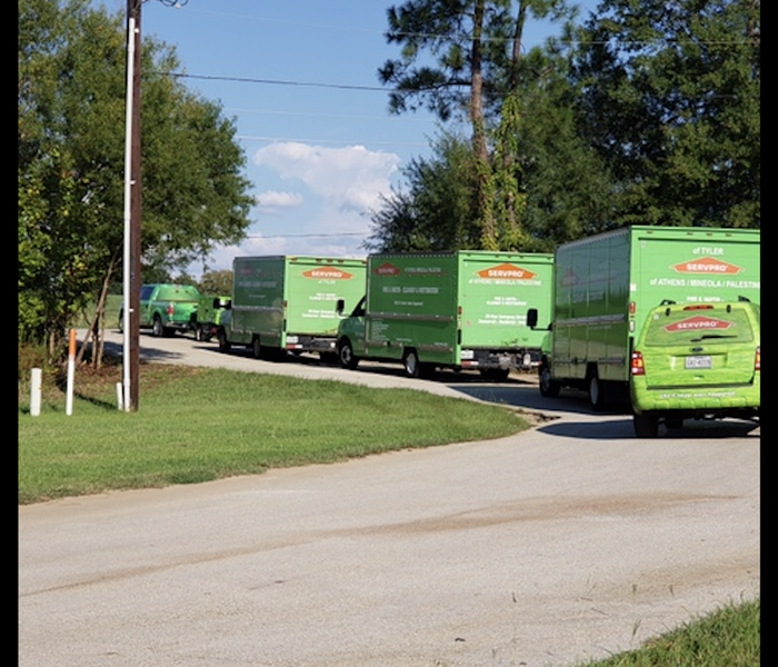 SERVPRO trucks driving away.