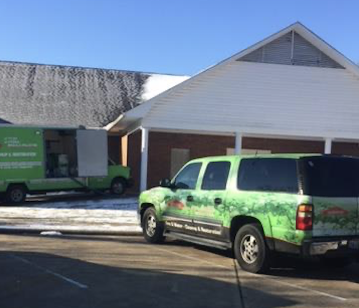 SERVPRO vehicle and trailer parked outside of a church.