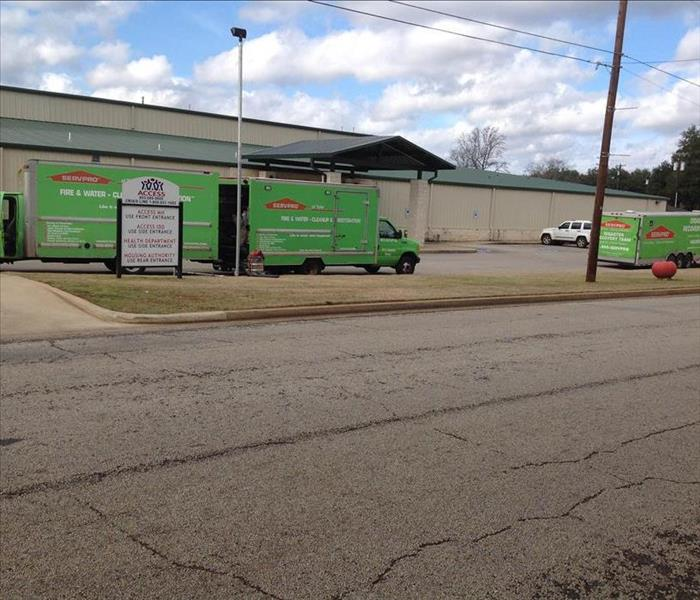 parking lots with SERVPRO trucks parked.