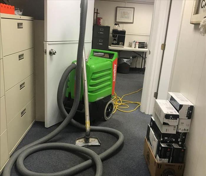 An office with SERVPRO equipment inside.